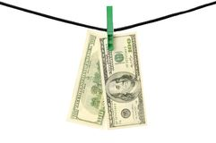 Dollars hanging on a string. Isolated on a white Stock Photo
