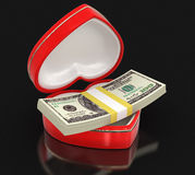 Dollars in the heart box (clipping path included) Royalty Free Stock Image