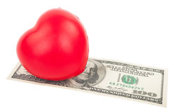 Dollars and heart Stock Photography