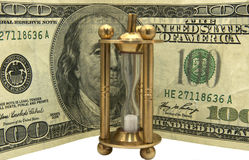 Dollars and hourglass Royalty Free Stock Photos