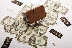 Dollars and House Stock Photography