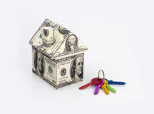 Dollars house. White background and money Stock Photo