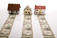 Dollars and Houses Stock Images
