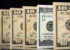Dollars. Hundred dollars among the ten dollar bills Royalty Free Stock Photos
