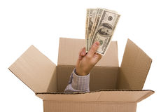 Dollars inside. Hand with dollars inside a cardboard box Stock Image