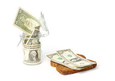 Dollars in a jar and on a slice of bread Stock Photos
