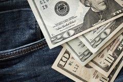 Dollars on jeans Stock Photo