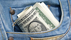 Dollars in jeans pocket Royalty Free Stock Images