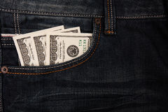 Dollars in jeans pocket Royalty Free Stock Image