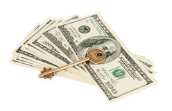 Dollars with a key Stock Photos