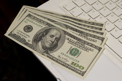 Dollars on a keyboard of a laptop Royalty Free Stock Photography