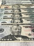 Dollars laid out on the top stock images