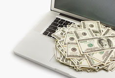 Dollars on laptop Royalty Free Stock Images