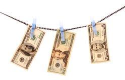 Dollars laundering Stock Photos