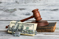 Dollars and law hammer. Royalty Free Stock Photography