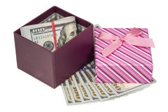 Dollars laying in red decorated gift box Royalty Free Stock Photos