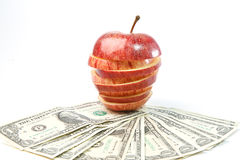 dollars lays on an apple Stock Image