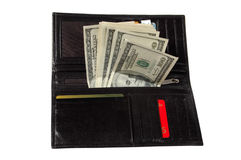 Dollars in a leather purse. Some hundred dollar denominations stick out of a leather man's purse Stock Photo