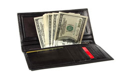 Dollars in a leather purse. Some hundred dollar denominations stick out of a leather man's purse Royalty Free Stock Photos