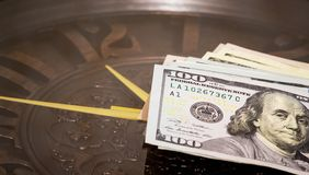 Dollars lie on the big clock. Time to earn money. Time is money_. Dollars lie on the big clock. Time to earn money. Time is money royalty free stock photos
