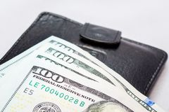 Dollars lie on a black purse. Money to make purchases. Earned mo Royalty Free Stock Image