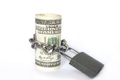 Dollars locked a chain Stock Photo