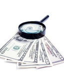 Dollars and loupe Royalty Free Stock Photography