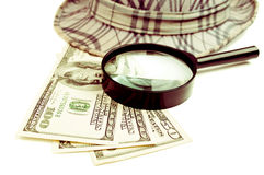 Dollars, loupe and hat Stock Image