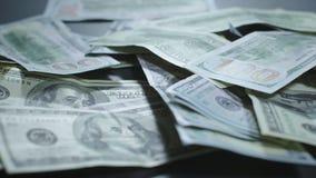 Dollars macro shooting. Money on table. Money slow motion. Franklin. Americans dollars macro shooting. One hundred