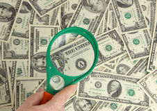 Dollars and magnifier Royalty Free Stock Photo