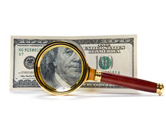 Dollars with magnifying glass. One hundred US Dollars with magnifying glass stock photography