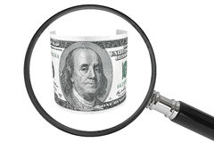 Dollars and Magnifying glass. Business concept. One hundred dollars and Magnifying glass on a white background Royalty Free Stock Photo