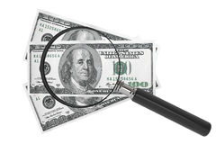 Dollars and Magnifying glass Royalty Free Stock Image