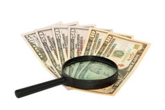Dollars and magnifying glass. On white background Stock Photos