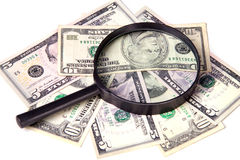 Dollars and magnifying glass on a white background Royalty Free Stock Image