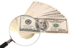 Dollars and magnifying lens Royalty Free Stock Image