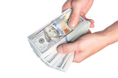 Dollars in man hand isolated on white background Stock Photos
