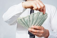Dollars in man's hand Royalty Free Stock Photography