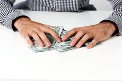 Dollars masculins de prise de mains Images stock
