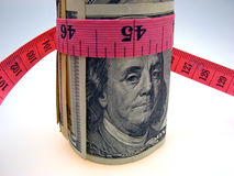 Dollars and measure ruler Stock Photography