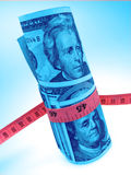 Dollars and measure ruler, closeup Royalty Free Stock Photography