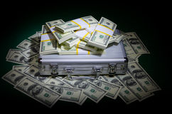 Dollars with metallic case Royalty Free Stock Photography