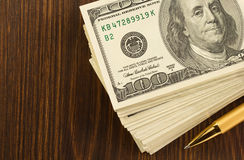 Dollars money banknotes on wood Stock Images