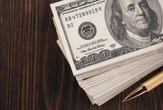 Dollars money banknotes on wood Stock Photos