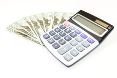 Dollars money with calculater on white background Stock Photography