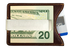 Dollars in money clip and credit card. Royalty Free Stock Photography