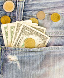 The dollars money and coin inside pants pocket jean. Royalty Free Stock Photos