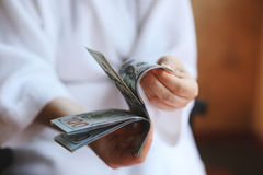 Dollars. Money in the hands Stock Images