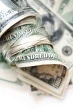 Dollars in money jar Stock Image