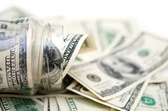 Dollars in money jar. On white background stock photos